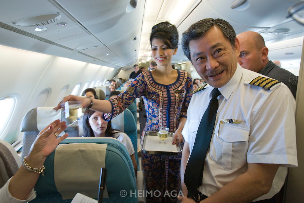 Airbus A380 first commercial flight - Singapore Airlines SQ 380 Singapore-Sydney on October 25, 2007. Singapore girl and co-pilot.