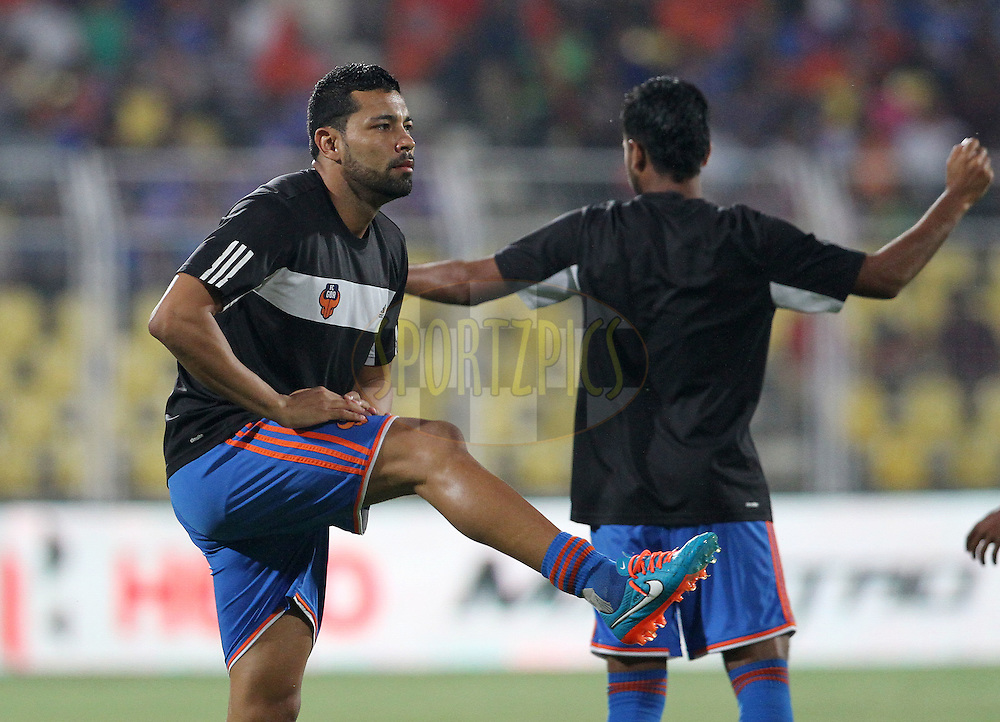 Andre Santos of FC Goa warm up before the start of the match 46 of the Hero Indian Super League between FC Goa and North East United FC held at the Jawaharlal Nehru Stadium, Fatorda, India on the 1st December 2014.<br /> <br /> Photo by:  Vipin Pawar/ ISL/ SPORTZPICS