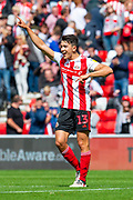 Luke O'Nien (#13) of Sunderland AFC celebrates at the final whistle of the EFL Sky Bet League 1 match between Sunderland and Portsmouth at the Stadium Of Light, Sunderland, England on 17 August 2019.