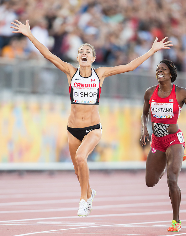 Melissa Bishop of Canada celebrates her win in the women's 800 metres at the CIBC Athletics Stadium at the 2015 Pan American Games in Toronto, Canada, July 22,  2015.  AFP PHOTO/GEOFF ROBINS