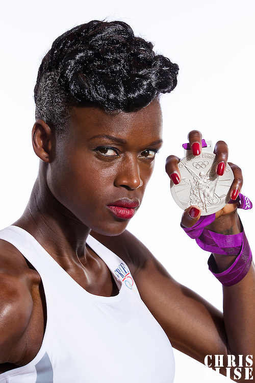 14 August 2012:  Olympic Silver Medalist Emilie Gomis (Team France Basketball) poses with her silver medal, at the Hotel Concorde Lafayette, in Paris, France.