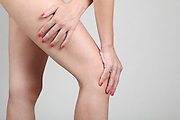 Woman massages her painful knee