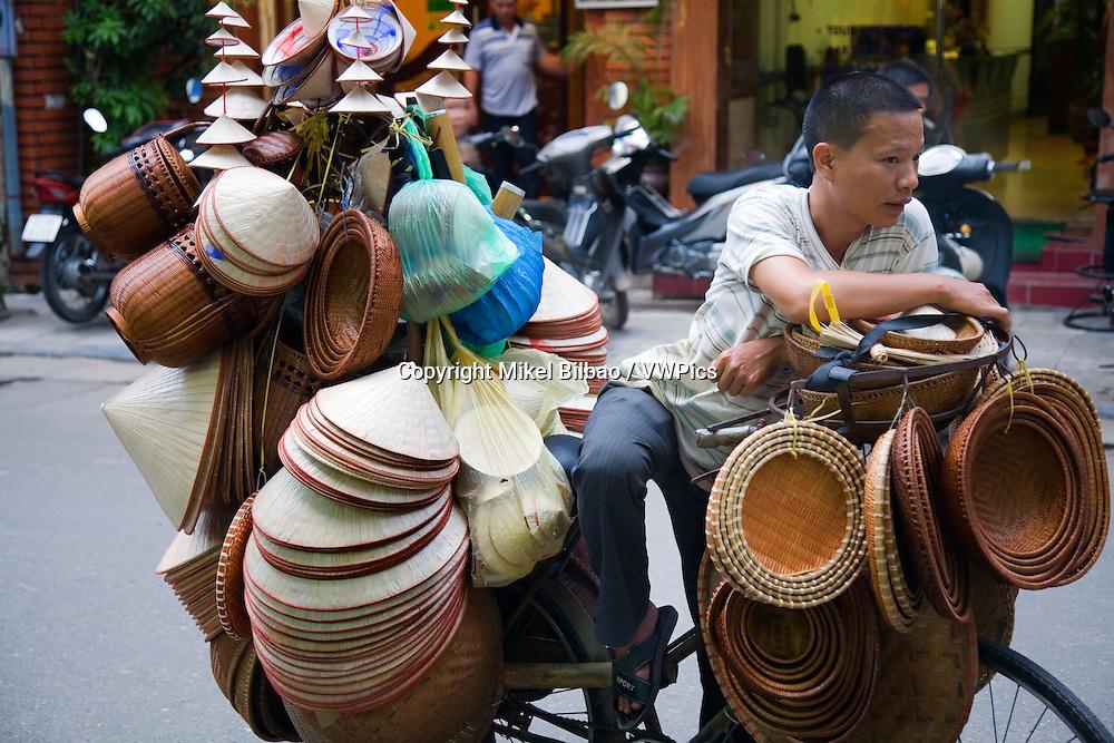 peddler.<br /> Hanoi, Vietnam.
