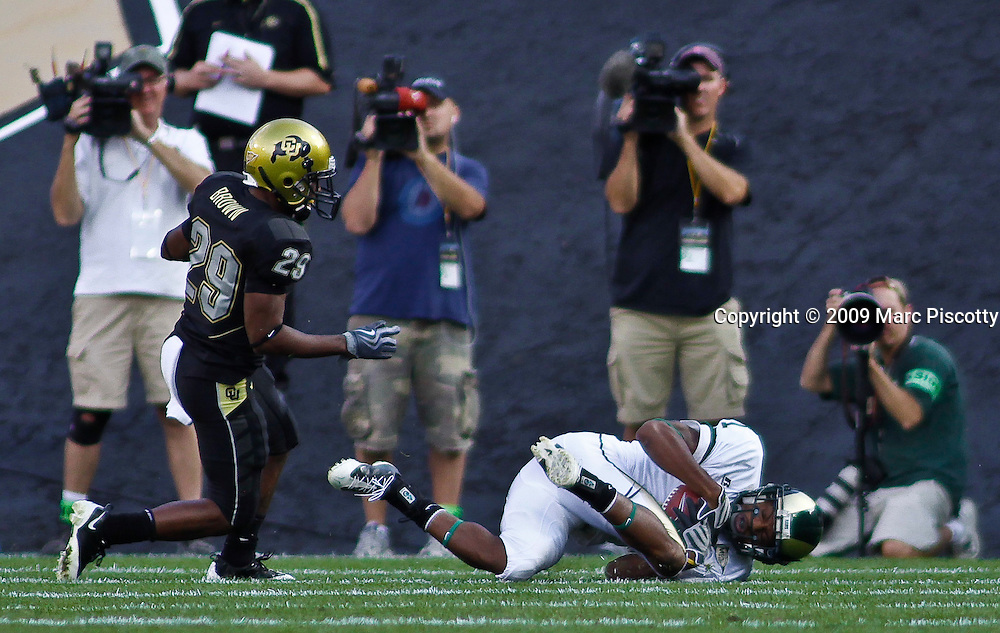 SHOT 9/6/09 5:59:15 PM - Colorado State's Ryan Gardner (#1) hits the ground after hauling in a pass in front of Colorado's Cha'pelle Brown (#29) during the first half of the 2009 Rocky Mountain Showdown at Folsom Field in Boulder, Co. Colorado State upset Colorado 23-17 in the game. (Photo by Marc Piscotty / © 2009)