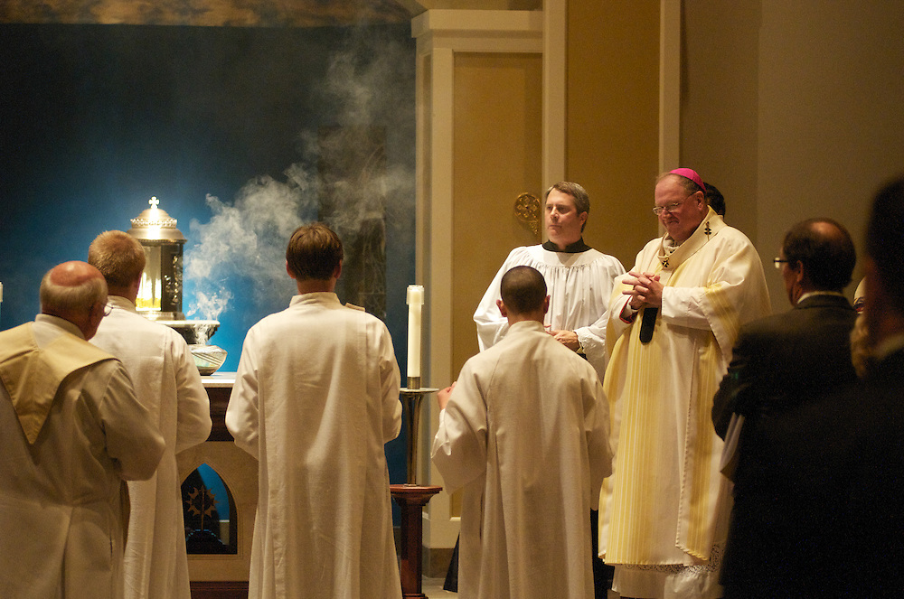 Archbishop Dolan burns incense on the altar during the dedication ceremony of the Three Holy Companions Chapel at Marquette University High School, Wednesday Nov. 5 2008. The burring of incense on the altar signifies Christ's sacrifice, which is commemorated every time the Eucharist is celebrated, as well as prayers rising to God.