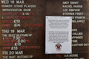 As the Coronavirus pandemic spreads across the UK, businesses and entertainment venues not already closed with the threat of job losses, struggle to stay open with growing rumours of a lockdown and travel restrictions around the capital. As Londoners start to work from home, a detail of closure at the Comedy Store where we see a list of recent comic acts, on 19th March 2020, in London, England.