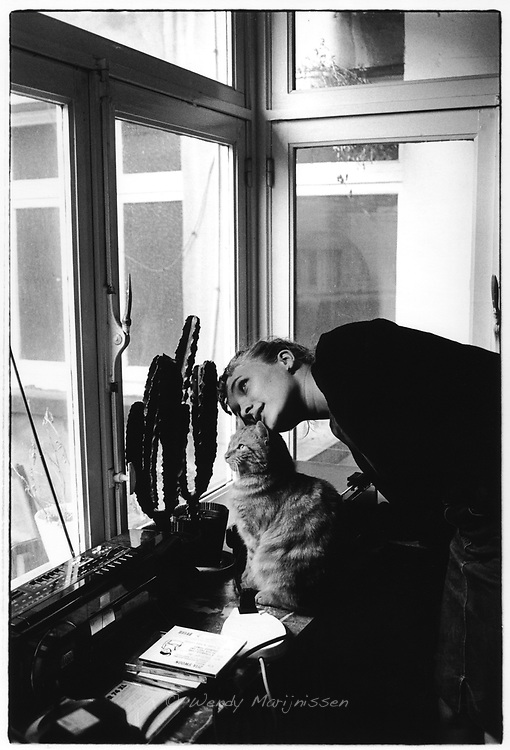 Actress and singer Tine Reymer at home with her cat. Antwerp, Belgium