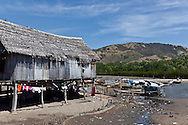 INDONESIA, Flores Archipelago, Tujuhbelas area, Riung village on seaside, houses on piles