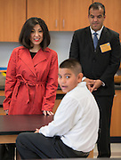 Houston ISD trustee Juliet Stipeche, left, and principal Eduardo Sindaco, right, talk with sixth grader Adrian Palacios during a classroom tour at The Rusk School, April 7, 2014.