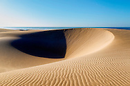 Sand dunes at the Lagoon of Khenifiss (Lac Naila), Atlantic coast, Morocco.