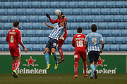 Swindon Town defender Brad Barry (27)  heads away from Coventry City midfielder Andy Rose (16)  during the Sky Bet League 1 match between Coventry City and Swindon Town at the Ricoh Arena, Coventry, England on 19 March 2016. Photo by Simon Davies.