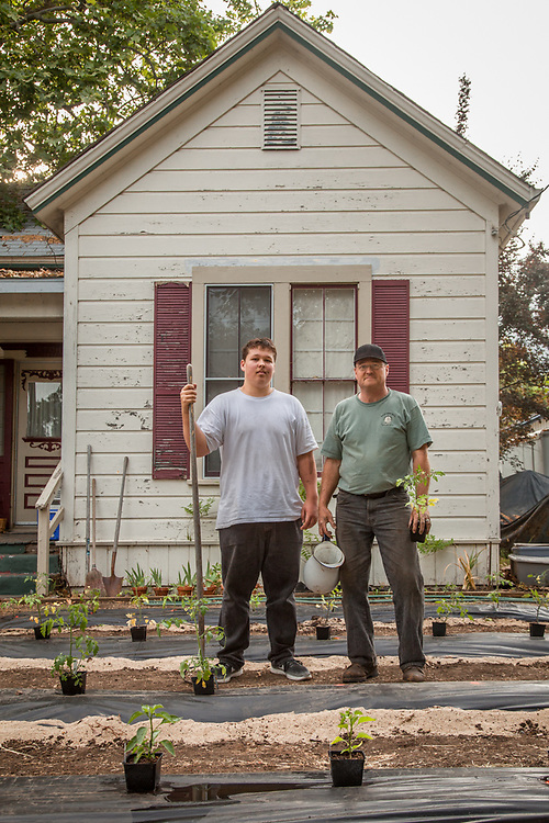 """Tony McBeardsley and his son, Will, in front of their house in Calistoga  """"We're a little late, but we are finally putting in our summer garden...this year we decided to convert the front lawn."""""""