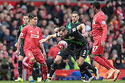 Erik Pieters (Stoke City) chests the ball to try and control while Roberto Firmino (Liverpool) watches on during the Barclays Premier League match between Liverpool and Stoke City at Anfield, Liverpool, England on 10 April 2016. Photo by Mark P Doherty.
