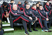 Manchester United interim Manager Ole Gunnar Solskjaer shares a smile and laugh with Manchester United Assistant Manager Mike Phelan on the bench with Michael Carrick first team coach of Manchester United and Kieran McKenna first team coach of Manchester United looking on during the Premier League match between Fulham and Manchester United at Craven Cottage, London, England on 9 February 2019.