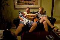 Floyd and his wife Leigh, a couple from North Carolina in the United States, sit with their newly adopted baby, Blake, in the Marriott hotel in Guatemala City, Guatemala on Saturday, June 18, 2005. Floyd, who declined to give his last name, said he expects that he and his wife will pay about U.S. $30,000 in total for Blake's adoption process, then the same again for another Guatemalan baby they plan to adopt.