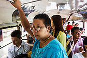 19 JUNE 2013 - YANGON, MYANMAR: Passengers on a bus in Yangon. Yangon buses are generally overcrowded and in poor repair but as the economy improves newer, but still used, Japanese and Korean buses are being imported. Hundreds of bus routes criss-cross Yangon, providing the cheapest way of getting around the city. Most fares are less than the equivalent of .20¢ US.   PHOTO BY JACK KURTZ