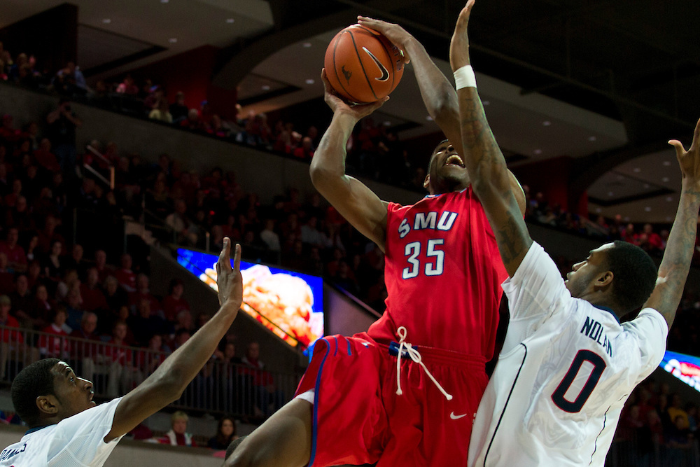 DALLAS, TX - JANUARY 4: Yanick Moreira #35 of the SMU Mustangs drives to the basket against the Connecticut Huskies on January 4, 2014 at Moody Coliseum in Dallas, Texas.  (Photo by Cooper Neill) *** Local Caption *** Yanick Moreira
