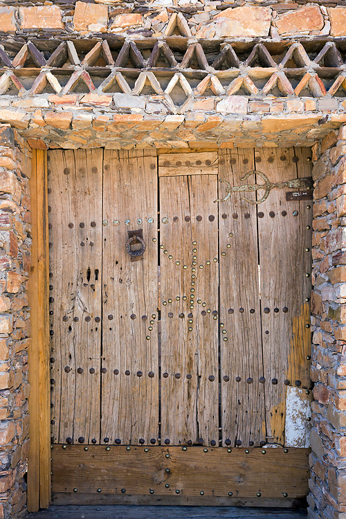IGHREM, MOROCCO - MAY 26TH 2016 - Close up of an old door to the Ighrem Granary, Souss Massa Draa, Southern Morocco.<br /> <br /> The symbol studded out by metal pins on the door is the 'yaz' symbol, which symbolises 'Free Man,' referring to the nomadic heritage of the Amazigh.