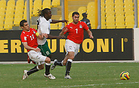 Photo: Steve Bond/Richard Lane Photography.<br /> Egypt v Zambia. Africa Cup of Nations. 30/01/2008. Ahmed Fathi (R) and  Kamel Hasan Ahmed (L) block the way for Isaac Chansa (C)
