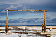 Front gate in light snow of western ranch