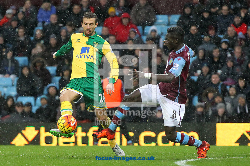 Gary O&rsquo;Neil of Norwich and Idrissa Gana of Aston Villa in action during the Barclays Premier League match at Villa Park, Birmingham<br /> Picture by Paul Chesterton/Focus Images Ltd +44 7904 640267<br /> 06/02/2016
