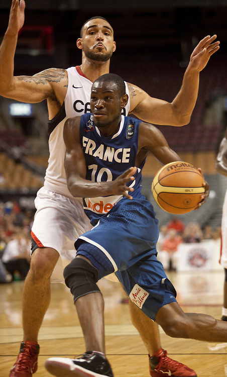 GJR503.jpg -20100812- Toronto, Ontario,Canada<br /> France's Yannick Bokolo drives past Canada's Robert Sacre during a game in the 2010 Jack Donohue International Classic tournament in Toronto, Canada, August 12, 2010. Canada defeated France 69-58.<br /> AFP PHOTO/Geoff Robins