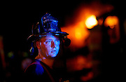 A North Augusta firefighter looks toward a crowd of people as North Augusta's historic Palmetto House Restaurant and Hotel burns late Thursday night. KENDRICK BRINSON/STAFF