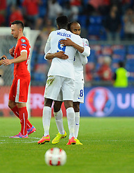 England's Fabian Delph (Aston Villa) congratulates England's Danny Welbeck (Arsenal) on the final whistle  - Photo mandatory by-line: Joe Meredith/JMP - Mobile: 07966 386802 - 08/09/14 - SPORT - FOOTBALL - Switzerland - Basel - St Jacob Park - Switzerland v England - Uefa Euro 2016 Group E Qualifier