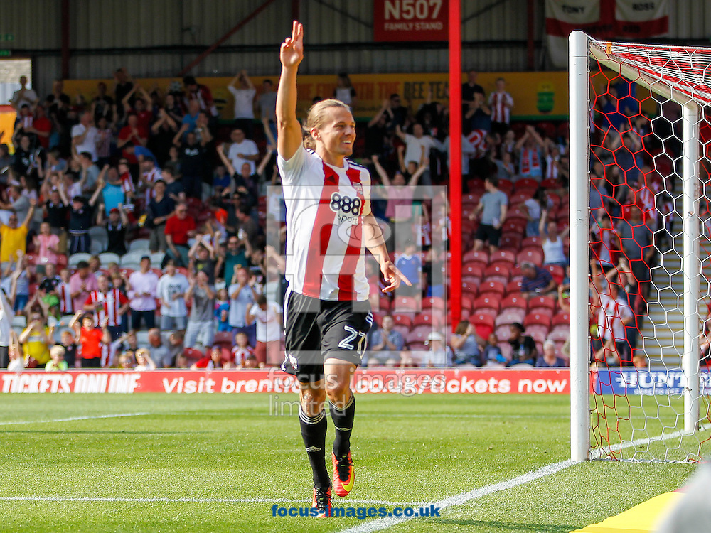 Lasse Vibe of Brentford celebrates scoring the opening goal during the Sky Bet Championship match between Brentford and Sheffield Wednesday at Griffin Park, London<br /> Picture by Mark D Fuller/Focus Images Ltd +44 7774 216216<br /> 27/08/2016