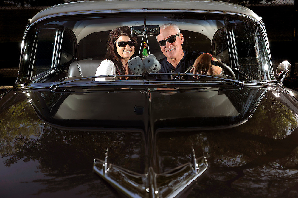 Tampa Bay Rays' manager Joe Maddon along with his wife Jaye pose for a photograph in their classic car Wednesday, April 4, 2012 at Tropicana Field in St. Petersburg.