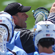 Johns Hopkins Head Coach Dave Pietramala huddles with his team during the second half of a NCAA Division I Men's Lacrosse Tournament game between the Defending national champion Duke and No. 8 ranked Johns Hopkins Sunday, May. 18, 2014 at Delaware Stadium in Newark, DEL
