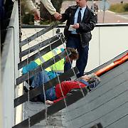 Vrouw gevallen op dak winkelcentrum Phohiflat Huizen