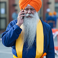 London, UK - 7 April 2013: a member of the Sikh community talks on the phone during the celebrations of Nagar Kirtan