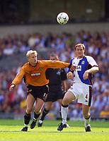 Photo. Jed Wee  DIGITALSPORT<br /> Blackburn Rovers v Wolverhampton Wanderers, FA Barclaycard Premiership, Ewood Park, Blackburn. 16/08/2003.<br /> Wolves' Steffen Iversen (L) and Blackburn's Martin Taylor contest a loose ball.