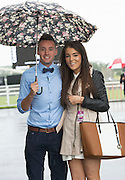 01/08/2014  Daniel O'Leary and Jennifer Carberry from Dublin  at a very wet Galway race track in Ballybrit for the Friday evening of the Galway races  .Photo:Andrew Downes