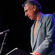 Tariq Latif, poet. Shore To Shore. Poets Carol Ann Duffy, Jackie Kay, Gillian Clarke, Imtiaz Dharker, Tariq Latif and musician John Sampson perform at the Burgh Halls, Dunoon at the end of Independent Bookshop Week. 23 Jun 2018. Credit: Photo by Tina Norris. Copyright photograph by Tina Norris. Not to be archived and reproduced without prior permission and payment. Contact Tina on 07775 593 830 info@tinanorris.co.uk <br /> www.tinanorris.co.uk