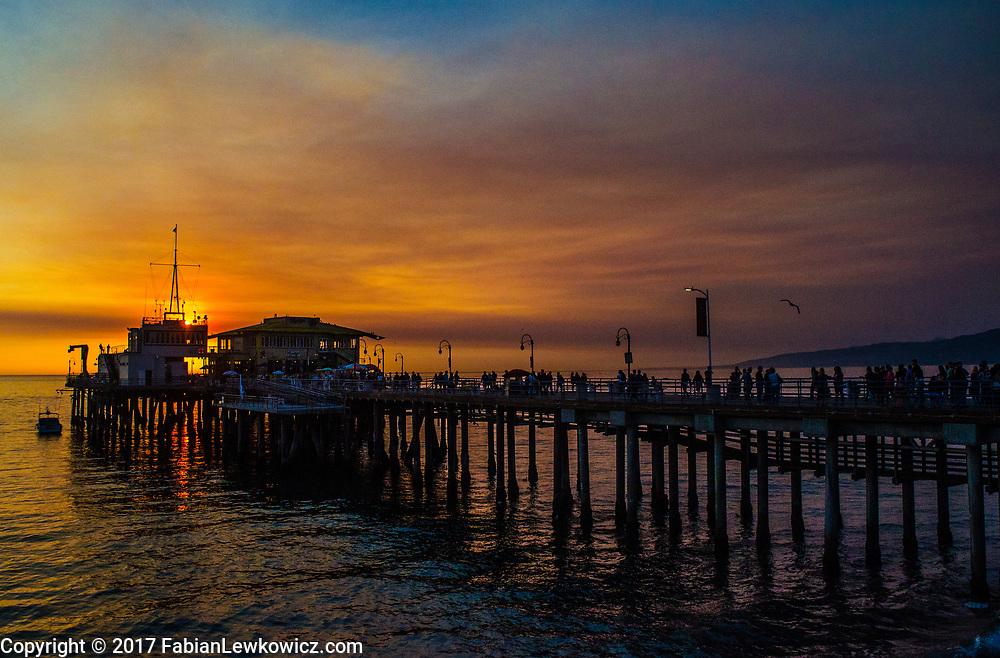 Santa Monica Pier amid the sunset on Friday, December 15, 2017.