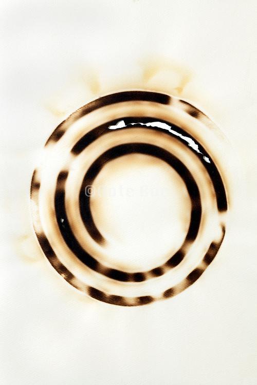 paper burned with a circular imprint