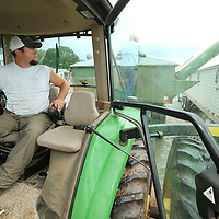 Justin Micahael keeps a close eye as the soybeans are loaded into the trailer for transport to Alabama.