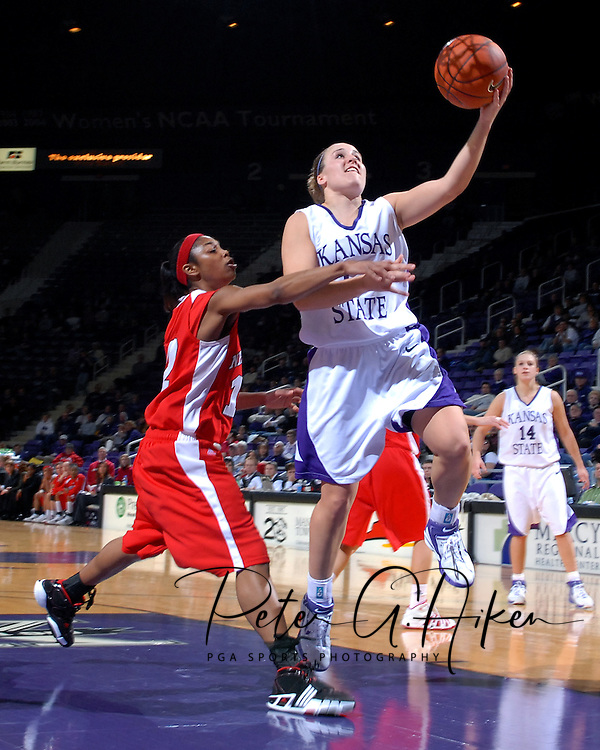 Kansas State's Kimberly Dietz (13) drives past Nebraska's Kiera Hardy (21) for the score, during the second half at Bramlage Coliseum in Manhattan, Kansas, February 7, 2007.  The Huskers defeated K-State 62-55.