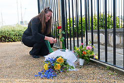 © Licensed to London News Pictures. 16/06/2017. LONDON, UK.  A friend lays flowers for Jo Cox. Neighbours and friends of Jo Cox attend The Great Get Together near Hermitage Moorings in Wapping to pay tribute and celebrate Jo's call that more unites us than divides us on the anniversary of her death. Jo Cox lived on a house boat in Wapping with her husband Brendan Cox and two children. Photo credit: Vickie Flores/LNP