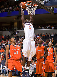 Virginia center Assane Sene (5) goes up for a dunk against Auburn.  The Auburn Tigers defeated the Virginia Cavaliers 58-56 at the University of Virginia's John Paul Jones Arena  in Charlottesville, VA on December 20, 2008.   (Special to the Daily Progress / Jason O. Watson)