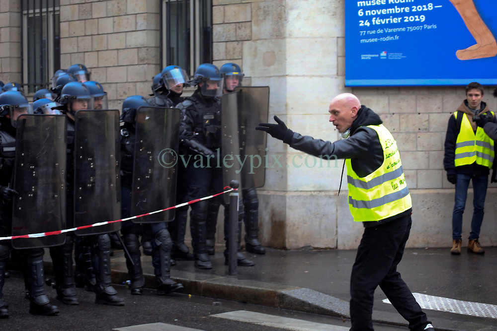 19 January 2019. Paris, France.<br /> Gilets Jaunes - Acte X take to the streets of Paris. A protester makes his feelings known to a wall of CRS riot police who have sealed a road along the route. An estimated 7,000 people took part in the looping 14 km route from Place des Invalides to protest tax hikes from the Government of Emmanuel Macron imposed on the people. An estimated 80,000 people took part in protests across the country. Regrettably the movement has attracted a violent element of agitators who often face off with riot police at the end of the marches which tends to deflect attention away from the message of the vast majority of peaceful protesters.<br /> Photo©; Charlie Varley/varleypix.com