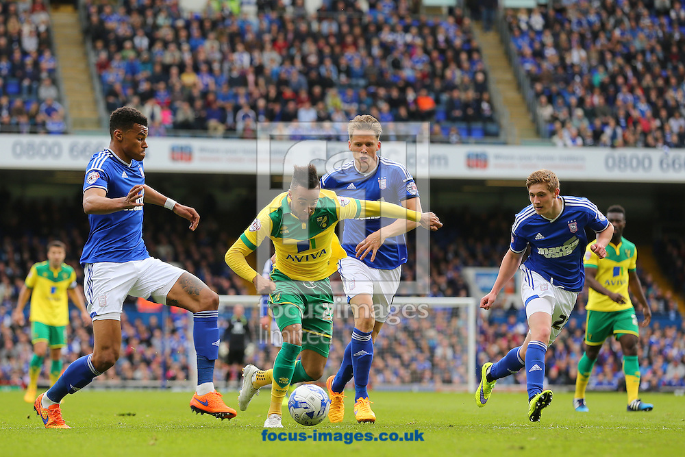 Nathan Redmond of Norwich City gets between, Tyrone Mings (left) Christophe Berra (centre) and Teddy Bishop (right) of Ipswich Town during the Sky Bet Championship play off semi final first leg at Portman Road, Ipswich<br /> Picture by Richard Calver/Focus Images Ltd +44 7792 981244<br /> 09/05/2015