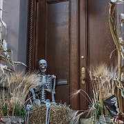 Halloween  skeleton and decorations on front stairs to brownstone in Greenwich Village, NYC.