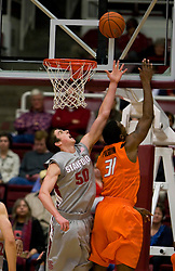 December 16, 2009; Stanford, CA, USA;  Oklahoma State Cowboys forward Matt Pilgrim (31) shoots over Stanford Cardinal forward Jack Trotter (50) during the first half at Maples Pavilion.  Oklahoma State defeated Stanford 71-70.