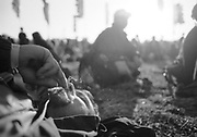 A man smoking a spliff, lying on the grass, Glastonbury, 2003<br /> MODEL RELEASED
