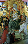 Madonna del Ceppo'. Virgin and Child enthroned, flanked by St John the Baptist and another saint, with donor and family kneeling.  Fra Filippp Lippi (c1406-1469) Italian painter.