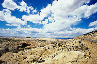 Cloudscape above rocky landscape
