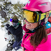 Sam Pope (back) and Kim Havell look on as Jess McMillan prepares to drop a line in the Teton backcountry.